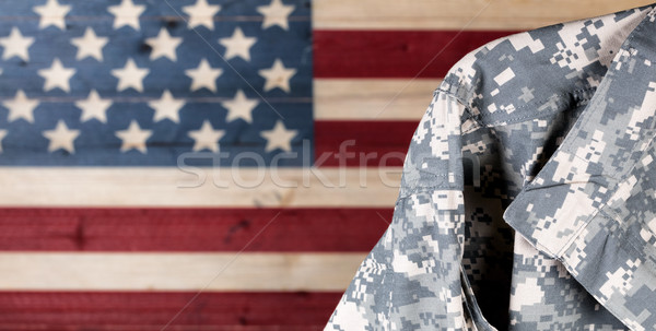 Military uniform with faded boards painted in American USA flag  Stock photo © tab62