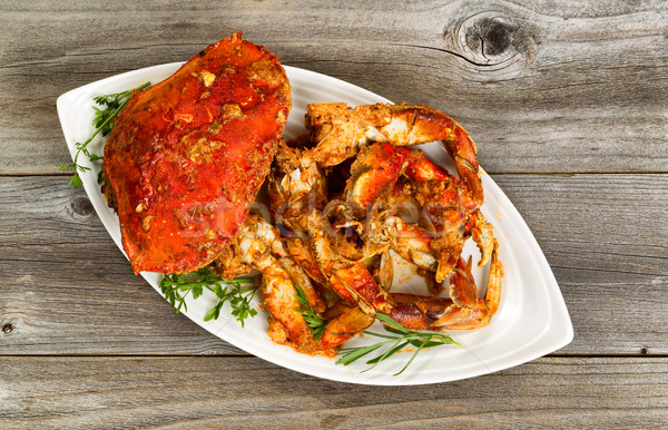 Spicy cooked crab ready to serve on white plate with rustic wood Stock photo © tab62