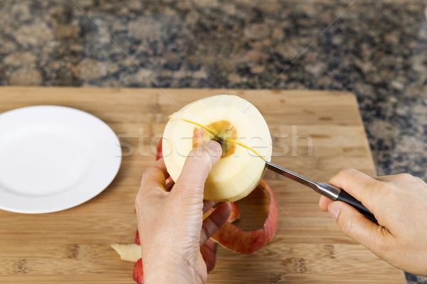 Stock photo: Cutting Apple in Half with Paring Knife