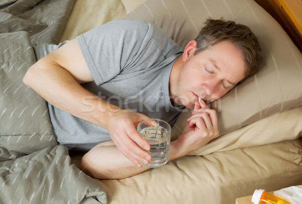 Man taking Pill for cold  Stock photo © tab62