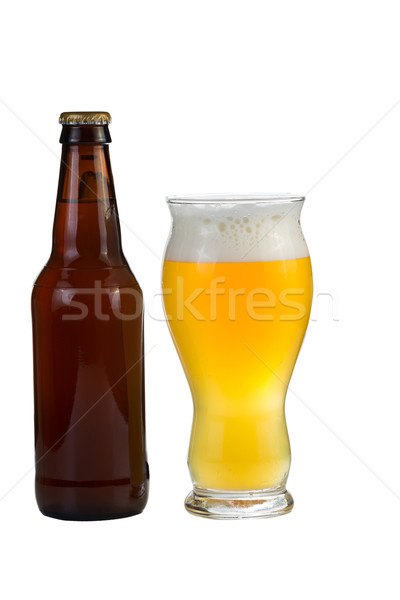 Unopened bottle of beer along with a full glass of beer  Stock photo © tab62