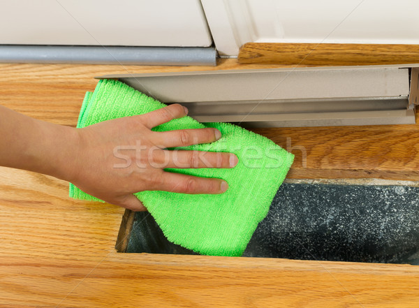Cleaning Dust from inside of floor heat vent  Stock photo © tab62