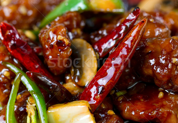 Spicy red hot Chile peppers with chicken and vegetables dish Stock photo © tab62