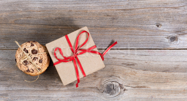 Baked cookies and a holiday gift on rustic wooden boards Stock photo © tab62