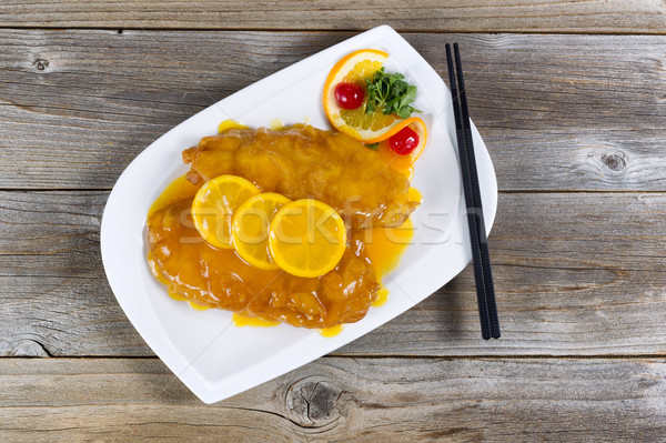 Bread coated fried chicken with lemon sauce ready to eat Stock photo © tab62