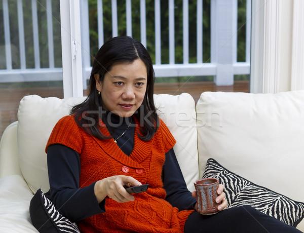 Relaks kanapie asian kobieta posiedzenia biały Zdjęcia stock © tab62
