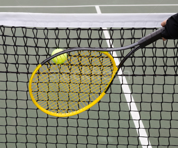 Tennis Ball into Net during game  Stock photo © tab62