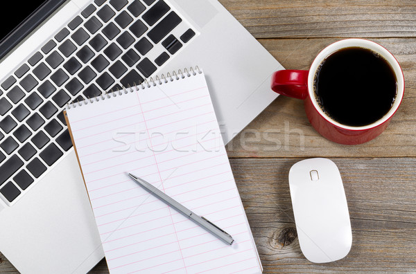 Blank notebook and pen with laptop on office desktop  Stock photo © tab62