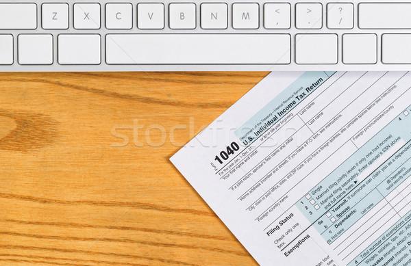 Desktop with basic IRS tax form Stock photo © tab62