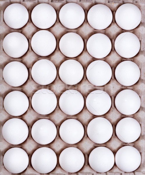 Cardboard carton filled with fresh whole white eggs  Stock photo © tab62