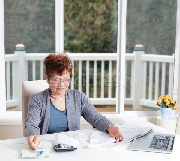 Senior woman showing frustration while working on her financial  Stock photo © tab62