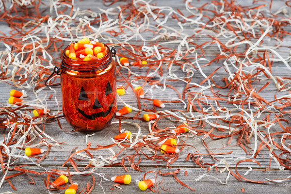 Scary Halloween pumpkin jar filled with candy  Stock photo © tab62
