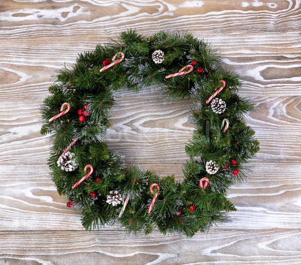 Christmas wreath with lights and candy canes on white wooden boa Stock photo © tab62