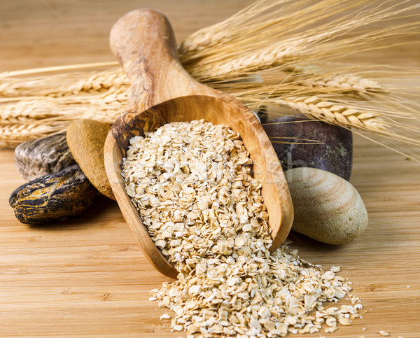 Wooden spoon filled with Raw Rolled Oats  Stock photo © tab62