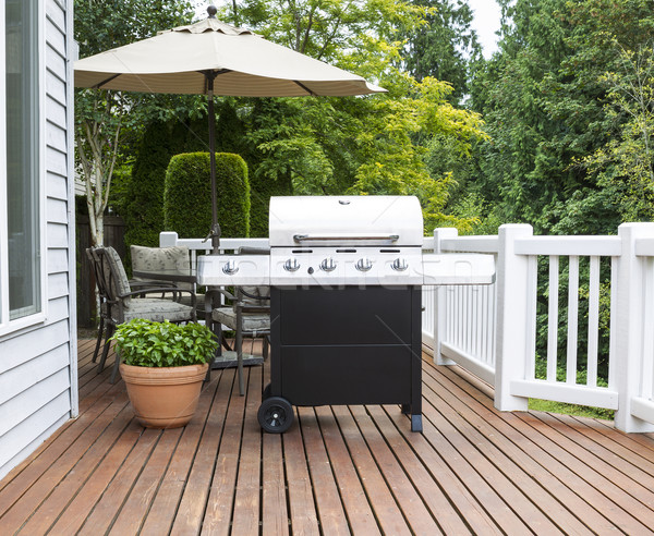 Large barbecue cooker on cedar deck Stock photo © tab62