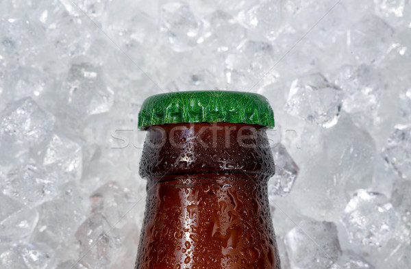 Single beer bottle cap cooling down on pile of ice  Stock photo © tab62