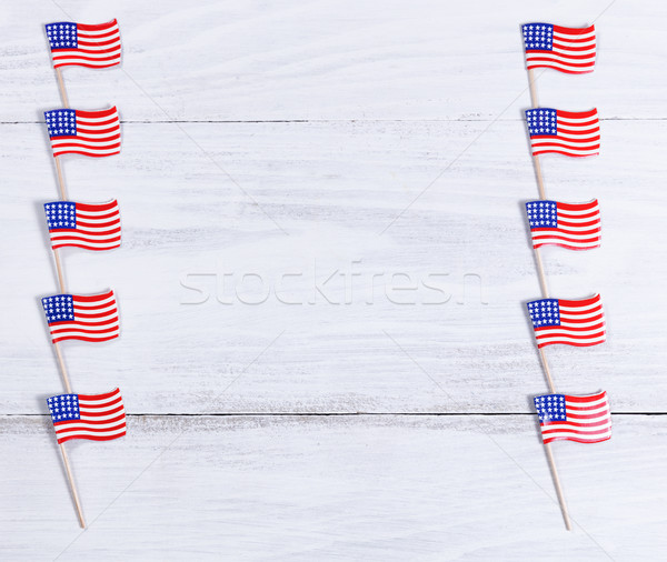 Small USA flags on each sides of white wooden boards   Stock photo © tab62