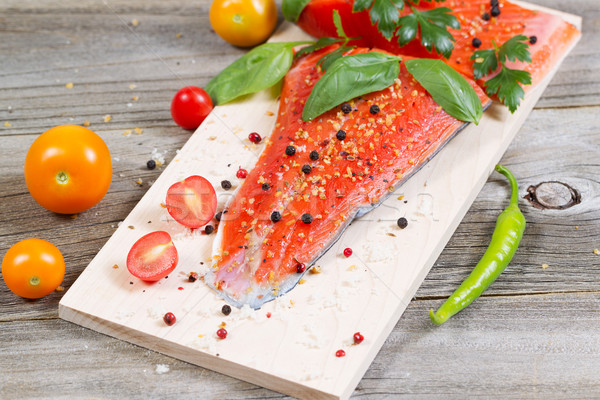 Fresh Salmon and ingredients on Wooden Cooking Plank  Stock photo © tab62