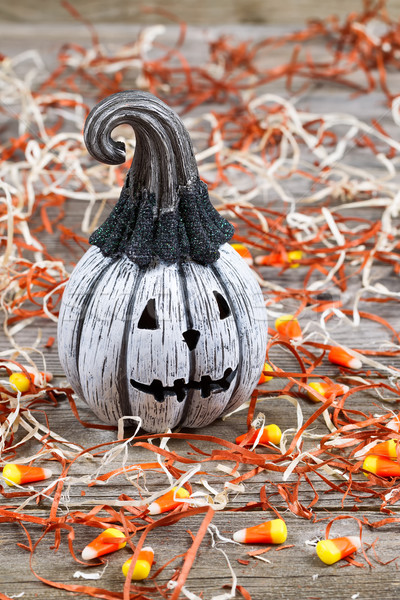 Scary black and white Halloween pumpkin on rustic wood   Stock photo © tab62