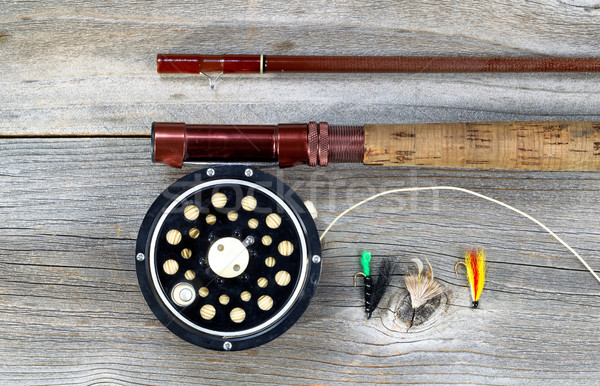 Old fly reel and rod on rustic wood  Stock photo © tab62