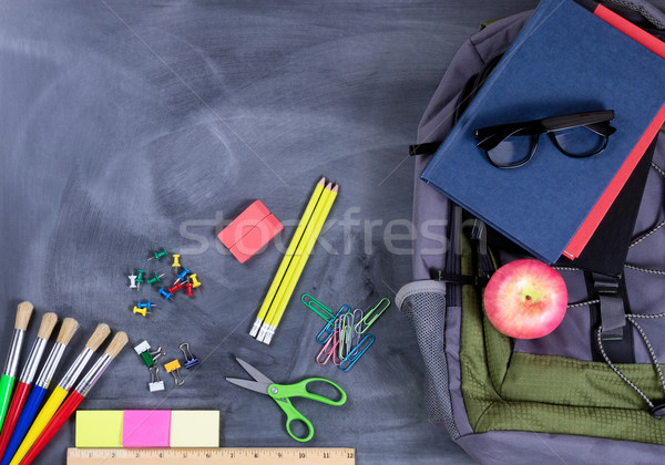 Back to school supplies and backpack on chalkboard background Stock photo © tab62