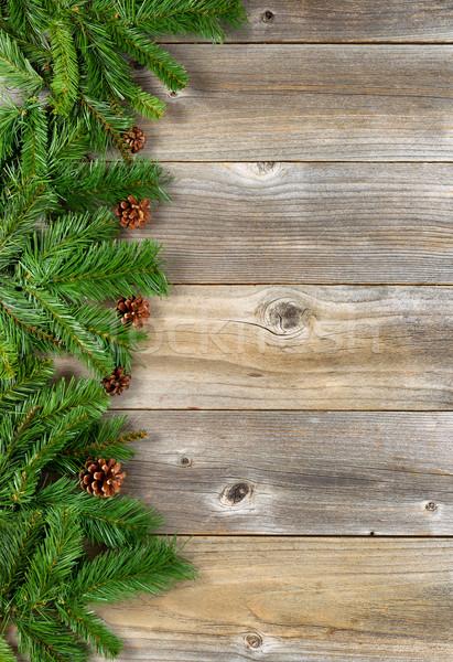 Karácsony keret örökzöld ágak rusztikus fából készült Stock fotó © tab62