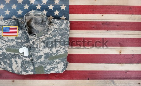 Pistol and ID tags with USA national flag colors painted on fade Stock photo © tab62