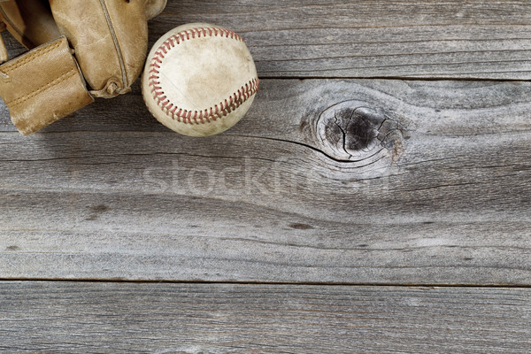 Old Baseball Mitt with used ball on rustic wood  Stock photo © tab62