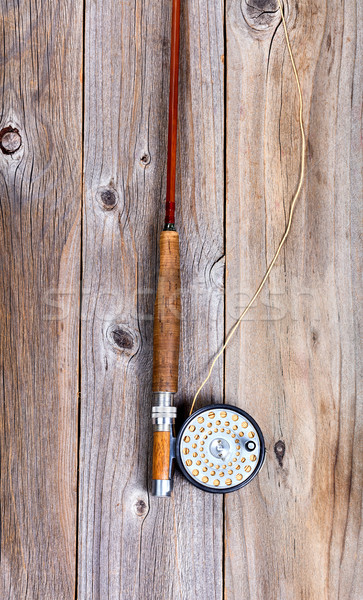 Vintage fly rod and reel on rustic wooden boards Stock photo © tab62