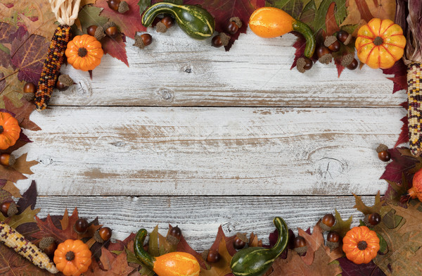 Complete circle border of Autumn foliage with other fall decorat Stock photo © tab62