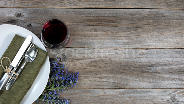 Vintage dinnerware on rustic wooden table with flowers and a gla Stock photo © tab62