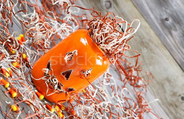 Angled scary orange pumpkin jar on rustic wood   Stock photo © tab62