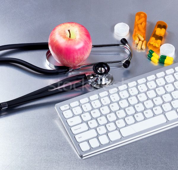 Computer and medical equipment with medicine on stainless steel  Stock photo © tab62