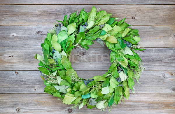 Seasonal green leaf wreath on rustic cedar wood Stock photo © tab62