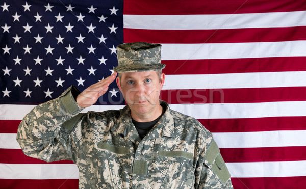 Male veteran solider saluting with USA flag in background  Stock photo © tab62