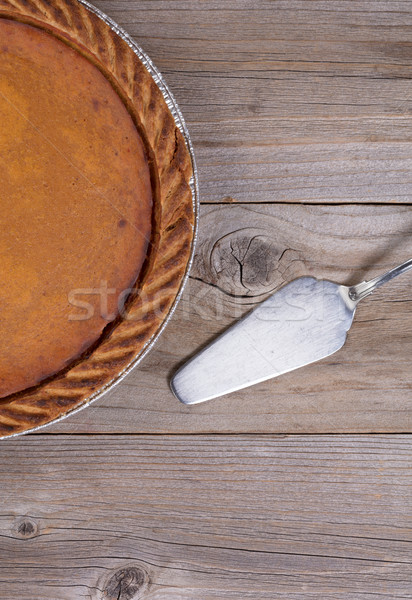Freshly baked pumpkin pie with spatula on stressed wooden table  Stock photo © tab62