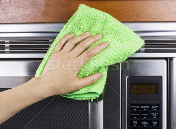 Cleaning Kitchen Appliance Fan Vents on Microwave Oven  Stock photo © tab62