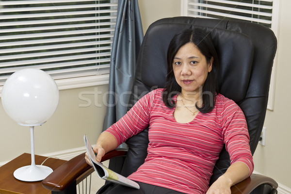 Relaxing at home in massage chair Stock photo © tab62