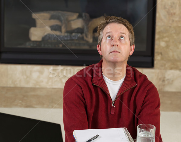 Mature man looking up to ceiling in frustration while working fr Stock photo © tab62