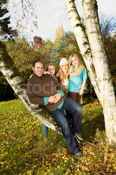 Happy Family Resting Outdoors during a nice day in fall season  Stock photo © tab62
