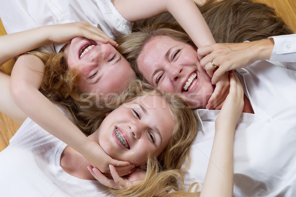 Family Circle of Mother and her girls on the floor  Stock photo © tab62