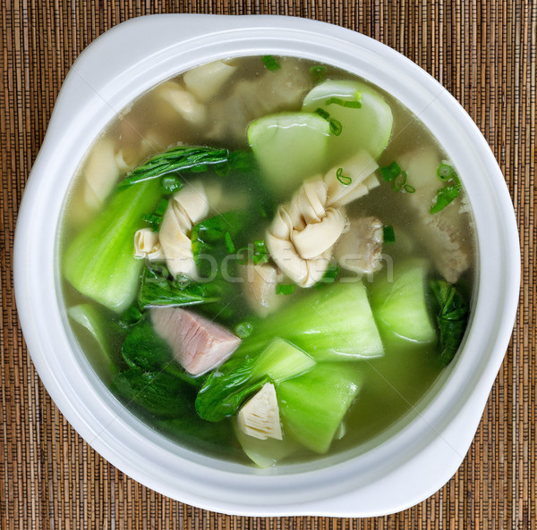 Fresh Asian meat and veggie soup on bamboo mat background Stock photo © tab62