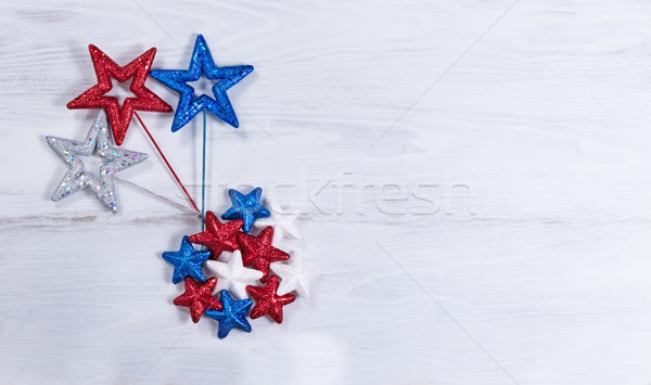 USA holiday stars in exploding pattern on white wooden boards   Stock photo © tab62