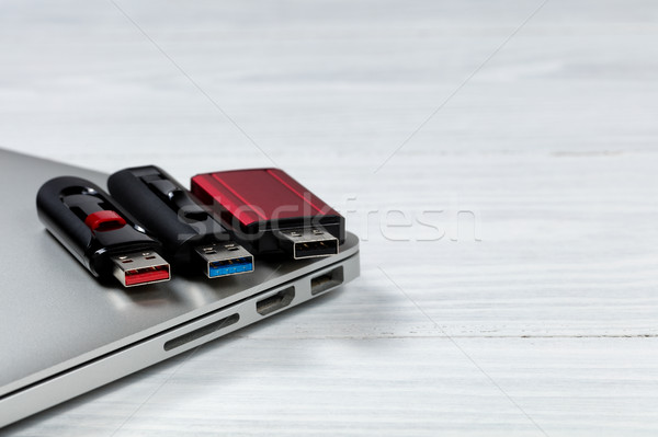 Thumb drives with different colors for USB speed technologies on Stock photo © tab62