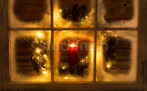 Snow covered window with glowing candle and decorative Christmas Stock photo © tab62