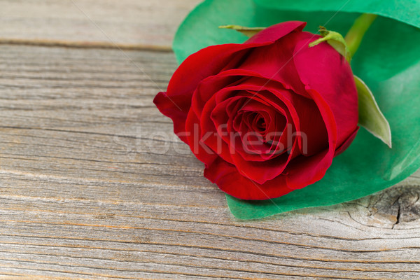 Happy Valentines day with single freshly cut red rose on rustic  Stock photo © tab62