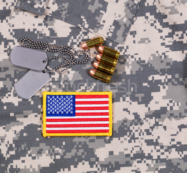 USA flag patch, ID tags, bullets on military battle dress unifor Stock photo © tab62