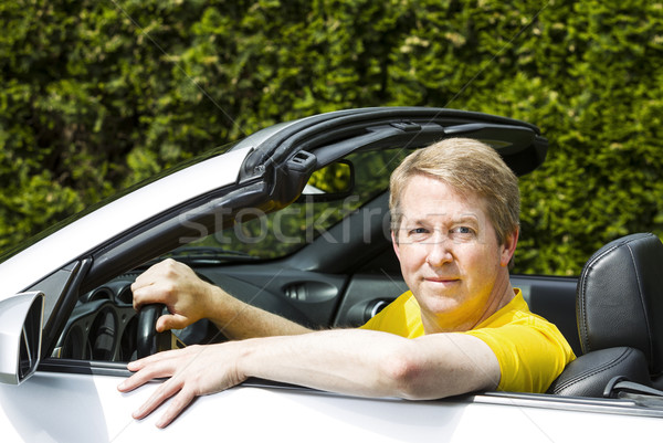 Mature man relaxing in convertible car  Stock photo © tab62