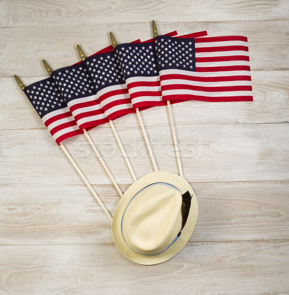 American Flags and Hat with feather on faded white wooden boards Stock photo © tab62