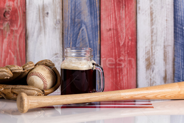Dark beer and baseball stuff with faded wooden boards painted in Stock photo © tab62